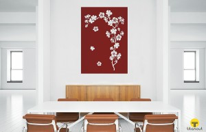 Brown metal panel with cherry branch pattern, on a wall in the middle of a white office, behind office table and six chairs