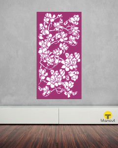 Purple laser cut screen with branch blossom pattern, on grey wall