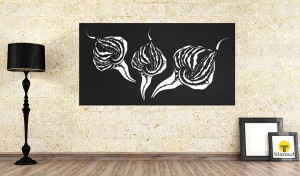 Black laser cut screen with calla pattern, on the brick wall. Black lamp on the left, two picture frames on the right side