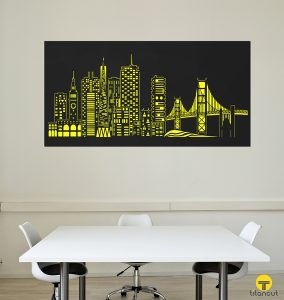 Laser cut metal panel with San Francisco cityscape pattern, on a white wall, behind white office table and 3 chairs